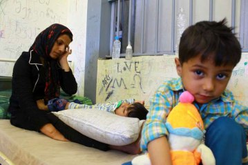 A mother and her children at a detention centre in Greece. Photo: UNHCR/J.Björgvinsson