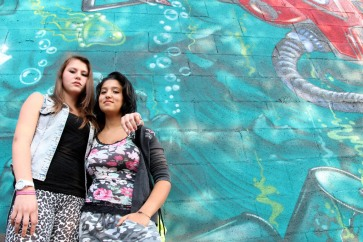 Daniela Cojocaru (left) and Chiara Dimastromatteo, both 16, stand next to a graffiti-covered wall in Turin, Italy. Daniela is originally from Moldova. Chiara does not attend school and does not have a job. Photo:UNICEF/Giacomo Pirozzi