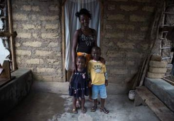 © UNICEF Sierra Leone/2014/Bindra | Mary, 15, at home with her brother and sister