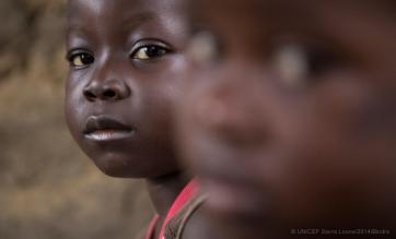 © UNICEF Sierra Leone/2014/Bindra |Amadou and his sister, Awa, at the family's home in Kenema, Sierra Leone