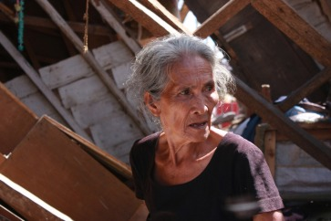 Seventy-seven-year-old Anacleta struggles to subsist in her storm-ravaged home following Typhoon Haiyan, which struck the Philippines in 2013. A UNISDR survey found that older persons are often excluded or marginalised when disaster management plans are being draw up at the community level. Photo: HelpAge International/Rosaleen Cunningham