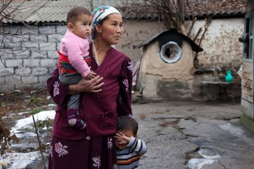 This stateless mother came to Kyrgyzstan from Tajikistan. Her children are also stateless as a result. Without papers proving her nationality, she cannot receive badly needed social assistance. Photo: UNHCR/Alimzhan Zhorobaev