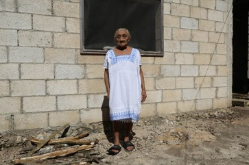 [An old person posing in front of her house in Chagas, Mexico, where long-lasting impregnated curtains were installed in order to keep the house free of the triamatone bugs. Photo: WHO/TDR /Isaias Montilla] An old person posing in front of her house in Chagas, Mexico, where long-lasting impregnated curtains were installed in order to keep the house free of the triamatone bugs. Photo: WHO/TDR /Isaias Montilla