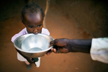In the Abu Shouk camp for internally displaced persons (IDP) in Darfur, a child gets a drink of water. Photo: UNAMID/Albert González Farran