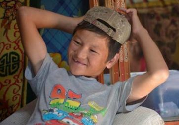 ***Photo: © UNICEF Mongolia/2014/Brake   Budgarav, 15, was injured while working as child jockey. He lost his front teeth and both his legs were broken.