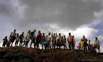© UNICEF/NYHQ2008-1227/Holt | Children stand on a hilltop overlooking a UNICEF-assisted child-friendly space in a Kibati camp for the displaced near Goma, Democratic Republic of the Congo.
