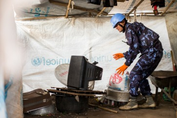 Military and police components of the UN Mission in South Sudan (UNMISS), conducted a search for weapons and restricted items at the Protection of Civilians (POC) site located in the Tomping area of Juba. UN Photo/JC McIlwaine