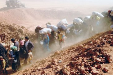Thousands of Syrian families flee into neighboring Jordan. Photo