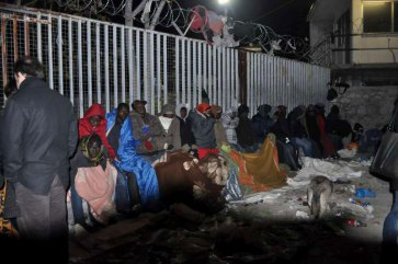 Lines of people sleep rough on Petrou Ralli Street in Athens, Greece, hoping to get an interview date and a pink card in the morning. Photo: UNHCR/K. Kehayioy
