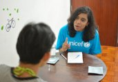 © UNICEF EAPRO/2014/Brown HIV specialist Shirley Mark Prabhu talks with Saeng about his situation.