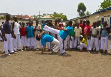 © UNICEF DRC/2015/Muntzer Instructors Rafael and Ninja show capoeira moves to a group of children who have been demobilized from armed groups, and now stay at a transition centre in Goma, Democratic Republic of Congo.