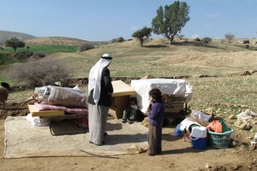 Displaced Palestinians with their belongings, following Israeli authorities demolition of their structures in Ein al Hilwa (Tubas Governorate) in the Jordan Valley on 30 January 2014. Photo: OCHA oPt