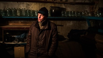 Nikolai grieves for his mother in a basement in Donetsk, Ukraine.   UNHCR/Andrew McConnell