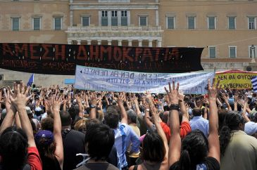 **Image: The moutza, an insulting gesture in Greek culture, is extensively used in the protests.   Author: Ggia   Wikimedia Commons