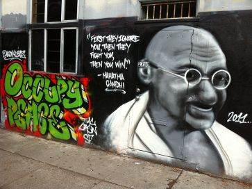 ***A wall graffiti in San Francisco containing a quote and image of Gandhi | Author: Victorgrigas | Wikimedia Commons