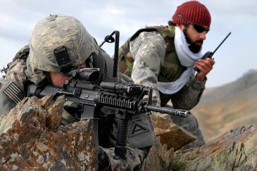 **Central photo: A US soldier and an Afghan interpreter in Zabul, 2009. | DoD photo by Staff Sgt. Adam Mancini, U.S. Army - Mountain Ridge Security | Wikimedia Xommons