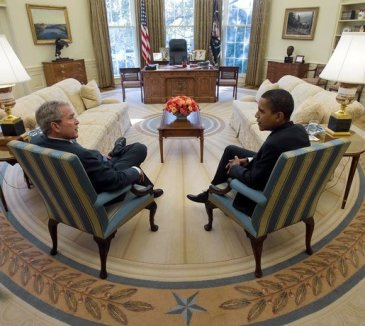**Photo: President George W. Bush and President-elect Barack Obama meet in the Oval Office of the White House Monday, November 10, 2008. Author: White House photo by Eric Draper