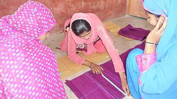 Ms Ahmad Sheikh trains other women in her village to stitch ©ILO