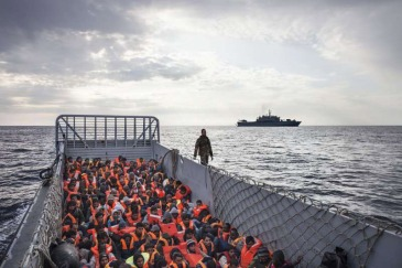 This Italian Navy landing craft is carrying 186 people who have been rescued at sea. Photo: UNHCR/A. D'Amato (file)