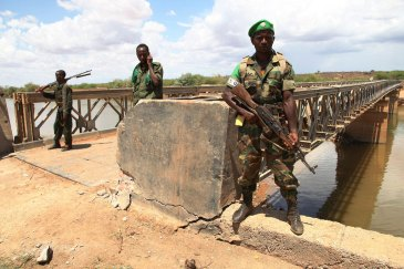 African Union troops guard a bridge over the Juba river near the town of Burdubow which they regained control of from Al Shabaab insurgents on 9 March 2014 during a joint operation with Somali National Army troops. Photo: AU/UN/IST/Mahamud Hassan