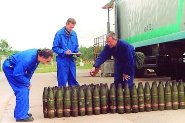Inspectors from the Organisation for the Prohibition of Chemical Weapons (OPCW) inventory a stockpile of 22mm chemical artillery projectiles (file photo). Credit: OPCW | Source: UN