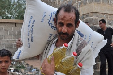 A farmer collects food ration for his family. An estimated 12 million Yemenis are food insecure. Photo: WFP | UN