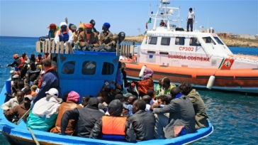 ***Photo: Kate Thomas/IRIN | A boat carrying migrants arrives in Lampedusa from Libya (file photo)