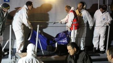 ***Photo: Francesco Malavolta/UNHCR | A 25-year-old women who did not survive the Mediterranean crossing is taken off an Italian coastguard vessel in a body bag