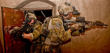 **(US) Army Rangers take part in a raid during operation in Nahr-e Saraj, Afghanistan Author: DVIDSHUB | Wikimedia Commons