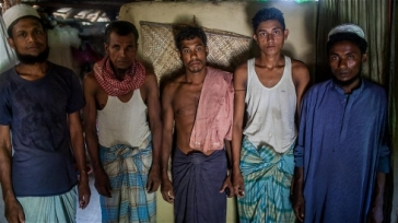 **Photo: S.H.Omi/UNHCR | A day or two before departing on a smuggler's boat, a group of Rohingya gather at a safe house.