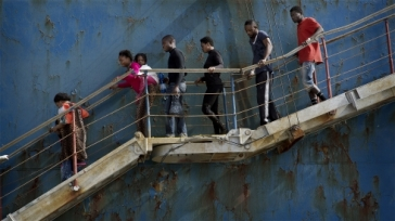 **Photo: Åsa Sjöström/IRIN | Migrants disembark at the Sicilian port of Catania after being rescued from a shipwreck by a merchant vessel on 5 May