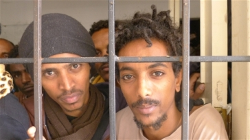 ****Photo: Tom Westcott/IRIN | These men fled indefinite military conscription in Eritrea, only to find themselves in a Libyan detention centre