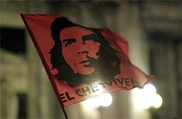 Guevara's face on a flag above the words