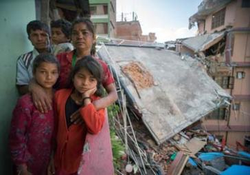 © UNICEF Nepal/2015/Sokol | Ganga and Jamuna (front left and right) with their mother, father and 4-year-old brother, Anju, at what was their home.