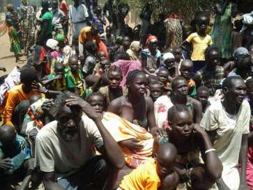 © UNHCR/R.Riek |  South Sudanese refugees wait to be registered at a crossing into Ethiopia earlier this year.