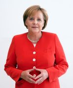 **Merkel with her hands in the characteristic Merkel-Raute position | Author: Armin Linnartz | Wikimedia Commons