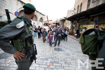 Palestinian Christians carry a cross (MEE/Ryan Rodrick Beiler)