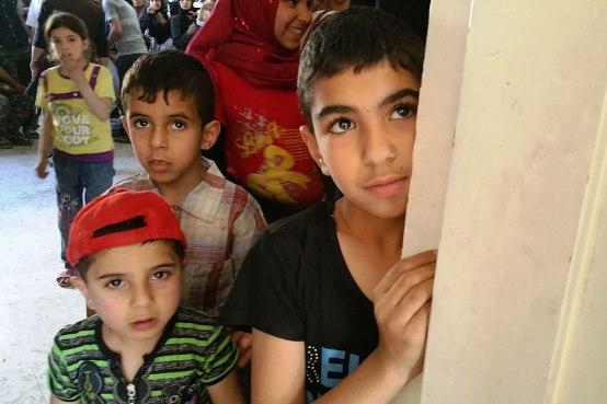 Children queue up at the UNRWA medical point in Yalda. Photo: UNRWA