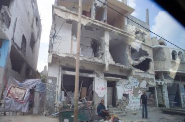 Homes damaged in Gaza during the devastating conflict in 2014. UN Photo/Eskinder Debebe