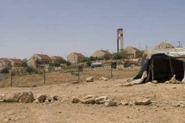 An Israeli settlement viewed from the Um-al-Kher bedouin community in the West Bank. Photo: OCHA