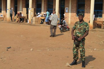 A soldier stands guard outside a polling station in Burundi's capital Bujumbura. Photo: MENUB