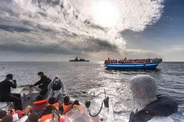 Italian Navy rescues boat filled with refugees and migrants in the Mediterranean last year. More than 2,100 people have died so far this year attempting to cross to Europe in over-crowded, flimsy vessels. | Source: UNHCR