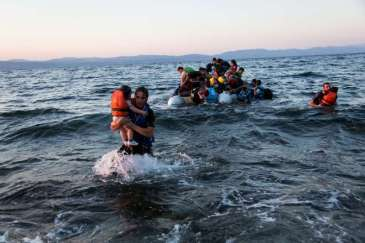© UNHCR/A.McConnell A group of Syrian refugees arrive on the island of Lesbos after traveling in an inflatable raft from Turkey, near Skala Sykaminias, Greece.