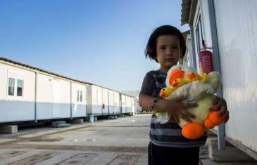 Five-year old Melina is staying with her mother, Marzia, at the new temporary accommodation site in Eleonas, Athens.