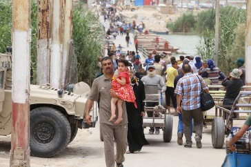 An increasing number of people, including families with children and the elderly, have encountered deadly ambushes as they try to escape areas controlled the Islamic State of Iraq and the Levant (ISIL). Photo: UNAMI