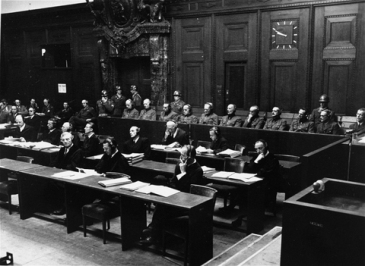 Defendants (rear) and their defenders in the hostage murder trial, 1947-48 [United States Holocaust Memorial Museum, courtesy of John W. Mosenthal | Source: WSWS