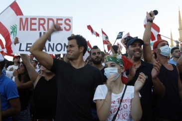 Lebanese people gather at the Martyrs' Square during a rally to protest the ongoing rubbish crisis (AA) | Source: Middle East Eye