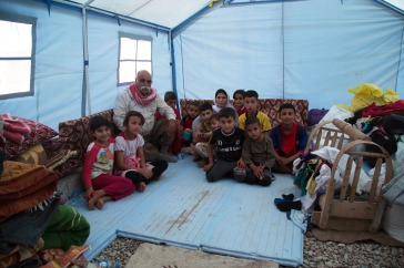 A family in the Sheikhan camp, outside of Dohuk – Kurdistan region of Iraq, Photo: OCHA/Charlotte Cans