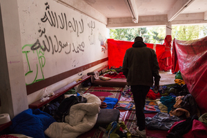 Makeshift dormitories have been set up indoors and, because there are so many people here, outdoors.