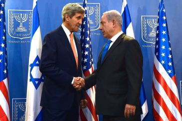 ***U.S. Secretary of State John Kerry shakes hands with Israeli Prime Minister Benjamin Netanyahu in Tel Aviv, Israel, on July 23, 2014, before the two sat down to discuss a possible cease-fire to stop Israel's fight with Hamas in the Gaza Strip. | Author: U.S. Department of State | https://www.flickr.com/photos/statephotos/14723426751/ | Wikimedia Commons